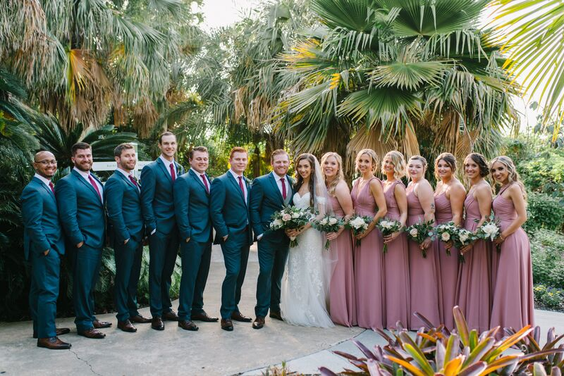 Jennifer Matteo Event Planning – Sarasota wedding planner – Sarasota luxury wedding planner – Sarasota weddings- Sarasota luxury weddings – Marie Selby Botanical Gardens – Marie Selby Gardens – Marie Selby Gardens wedding - bride and groom with wedding party - pink bridesmaids dresses