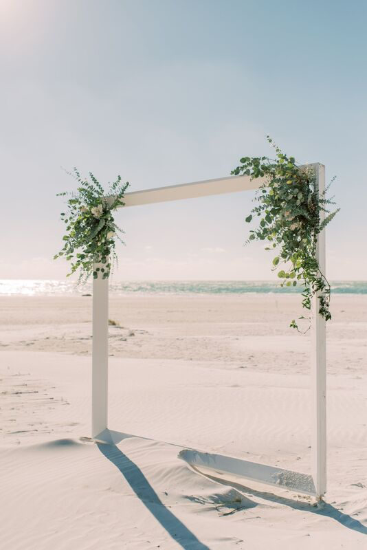 simple white wedding structure on Siesta Key for a beach wedding