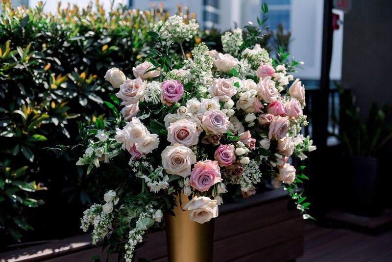 Jennifer Matteo Event Planning – Sarasota Wedding Planner – Sarasota wedding – Sage SRQ – pink and gold wedding – Sarasota root top wedding ceremony- Sarasota intimate wedding - gold trumpet vase with pink and white flowers