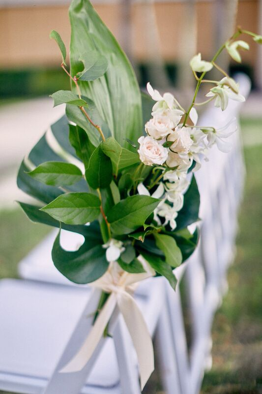 Jennifer Matteo Event Planning – Sarasota wedding planner- The Ritz-Carlton Sarasota – Ritz-Carlton Sarasota wedding- foodies – tropical floral – outdoor Sarasota wedding reception - aisle decor with tropical leaves