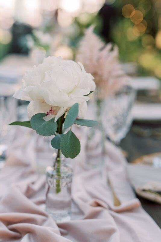 Soft pink flowers for a romantic and rustic Sunset Beach Resort wedding