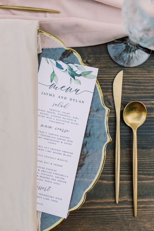Sunset Beach Resort wedding reception with custom menu card, gold flatware and vintage glass accents