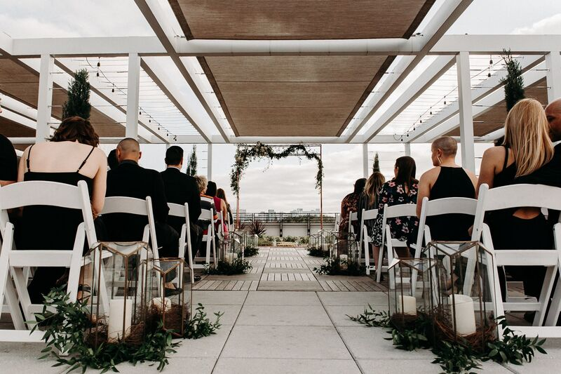 Tampa Wedding – Rooftop 220 – Armature Works- Jennifer Matteo Event Planning – Armature Works Wedding – Tampa wedding planner – Tampa LGBTQ wedding - rooftop wedding ceremony - metal wedding structure