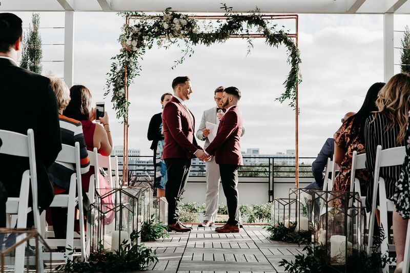 Tampa Wedding – Rooftop 220 – Armature Works- Jennifer Matteo Event Planning – Armature Works Wedding – Tampa wedding planner – Tampa LGBTQ wedding - rooftop wedding ceremony - to grooms -