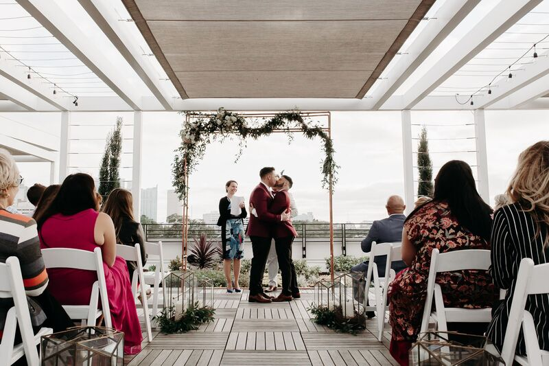 Tampa Wedding – Rooftop 220 – Armature Works- Jennifer Matteo Event Planning – Armature Works Wedding – Tampa wedding planner – Tampa LGBTQ wedding - rooftop wedding ceremony - two grooms