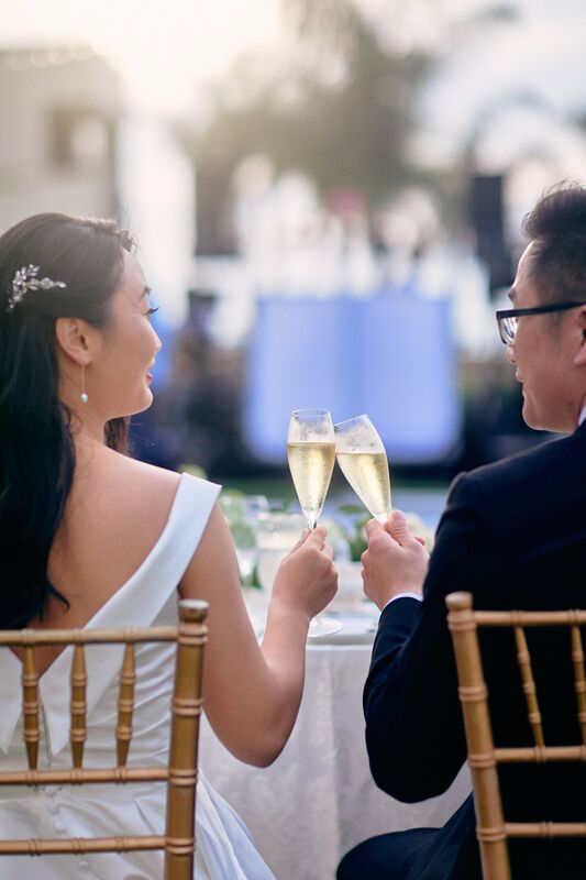 Jennifer Matteo Event Planning – Sarasota wedding planner- The Ritz-Carlton Sarasota – Ritz-Carlton Sarasota wedding- foodies – tropical floral – outdoor Sarasota wedding reception - cheers - bride and groom toasting