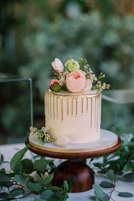 Gold drip wedding cake for an intimate wedding reception