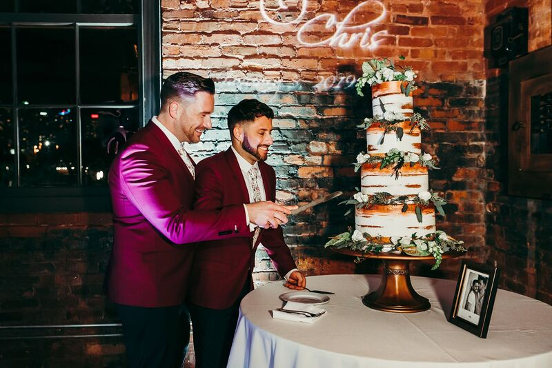 Tampa Wedding – Rooftop 220 – Armature Works- Jennifer Matteo Event Planning – Armature Works Wedding – Tampa wedding planner – Tampa LGBTQ wedding - two grooms - two grooms cutting cake