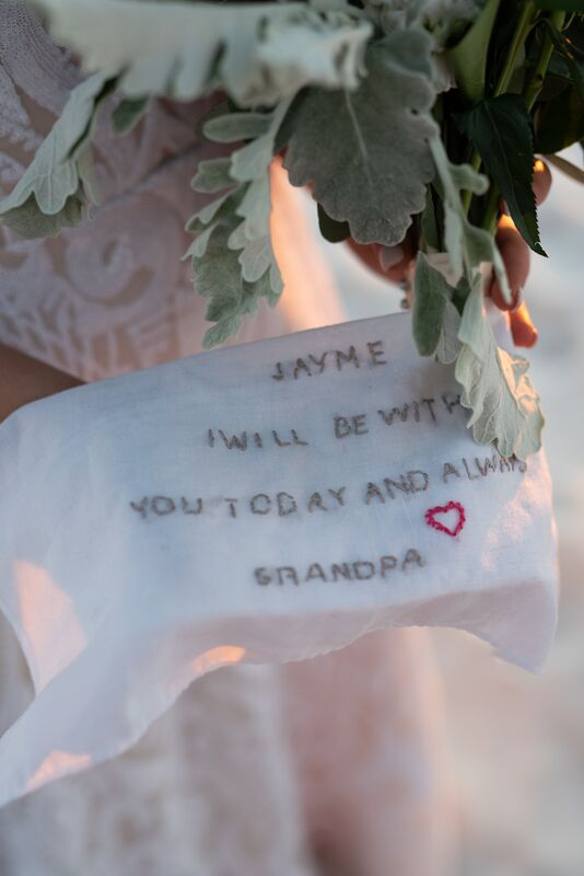 A hand stitched handkerchief with a note from the bride's grandfather