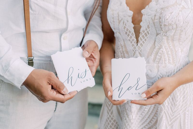 Siesta Key bride and groom holding His and Hers wedding Vow books