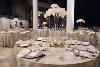 Jennifer Matteo Event Planning  - Sarasota wedding planner- Westin Sarasota – rooftop wedding- rooftop wedding reception - tall white orchid centerpieces