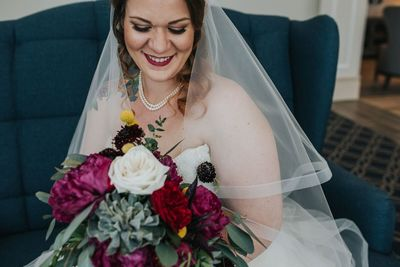 Jennifer Matteo Event Planning – Sarasota Wedding Planner- Mote Marine Laboratory – Longboat Island Chapel  - Florida Luxury Wedding Planner - bride with Burgundy bouquet - bridal bouquet with succulents